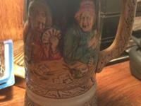 This lovely old beer stein from Germany features a man