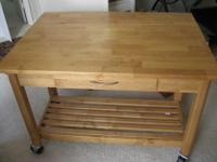 Nice kitchen/work table with fold up leaf. Table