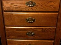 Hello! I'm selling my four drawer wood dresser. It's in