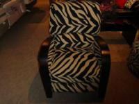 This zebra print chenille recliner is an exquisite