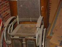 This is a antique vintage wicker wheel chair. I took