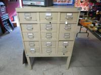 A NICE LOOKING CABINET WITH 15 DRAWERS,GREAT FOR TOOLS