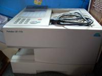 This is a Panasonic Panafax fax/printer machine, model