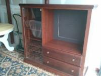 Selling this Cherry Armoire Entertainment Center which