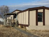 This mobile home is a 3 bedroom 2 bathroom. Located in