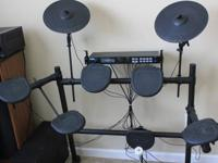 This Alesis DM-5 Electric Drumkit is great for any