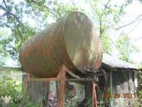 500 gallon over head fuel tank with stand. Hose and