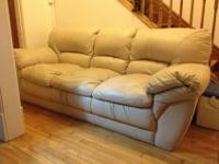 Matching cream leather couch and love seat set. Bought