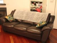 12 month old leather couch. Premium Italian leather,