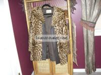This Ocelot Coat is in need of some repair. It is made