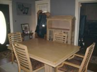 Dining Room Table and chairs with a china cabinet.