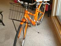 I am selling an orange cafe 8 deluxe edition bicycle.
