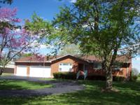 Country living on 2.62 acres. Brick ranch home offers
