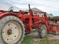 good running tractor with loader 4000 obo  roy just put