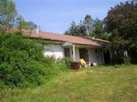 Earth-contact home on 27 acres. Large rooms, fireplace,