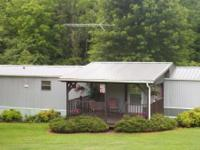 Remodeled 2 bedroom, 2 bath mobile home on  acre land