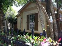 A charming Garden District cottage situated in between