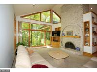 Spectacular home set on .98 acre with heavy tree