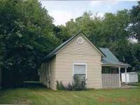 Many updates, cute Bungalow and includes a pellet stove