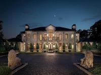 This impressive Norman French-style estate, clad in