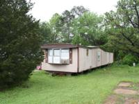 This 14x70(66)mobile home has 2 Bedrooms and 1.5 baths.