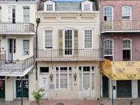 This handsome three-story c. 1820s masonry townhouse