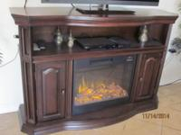 Up for auction is a 2 years of age electric fireplace.