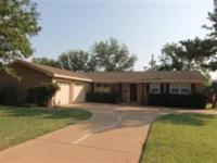 Great 3/2/2, brick ranch style home. First living area
