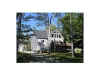 Privately situated along the shore of Graham Lake this