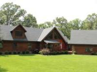 Beautiful 3-level log home on 4 acres. Country living