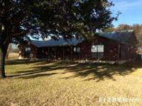 Home rests on about 70 acres. Has 3 ponds, 3 barns,