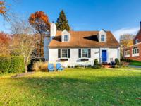Classic cape cod in the Chestnut Hill community of