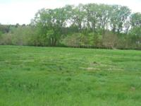 No builder attachment. Lot backs to wooded area. Horses