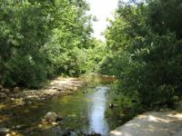 Missouri realty with acreage and live water. Low
