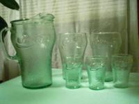 This is a vintage set of green Coca-Cola glasses with