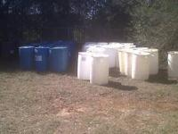 55 GALLON BARRELS SOLID WITH 2 HOLES IN TOP GOOD FOR