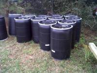 BLACK 55 GALLONS DRUMS, THEY ARE FOOD GRADE WITH