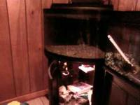used 55 gallon corner aquarium w/stand that has light