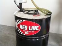 Two, red line racing oil 55 gallon drums (one black,