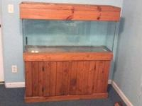 55 gallon tank, includes stand, hood, and some