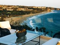 Set atop the oceanfront bluff in the private community