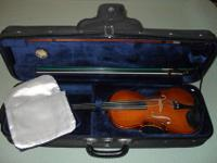 I am selling a 4/4 size violin, complete with two bows,