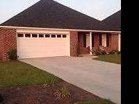 Beautiful brick 3 bedroom 2 bath corner lot home in