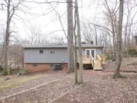 5516 Carving Tree Drive - Large Wooded Homesite with