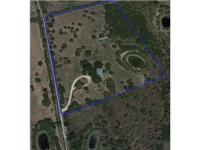 10.056 park like acres. Over 750 feet of frontage on