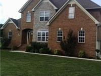 Exquisite home with stately features. Brick w/ accent