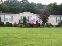 Doublewide is a 2004-3 bedroom/2 bath home featuring a