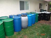 55 Gallon steel or metal barrels that are either open