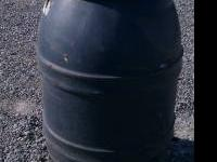 55 gallon plastic barrels with lids $22.00 Each or