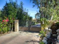 Beyond a private gated drive on secluded 1.3 acre
